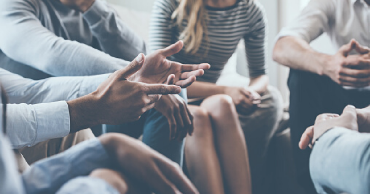 Image of people sitting in a circle and talking