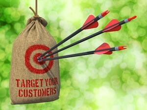 Target Your Customers - Three Arrows Hit in Red Target on a Hanging Sack on Green Bokeh Background.